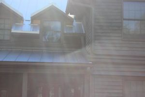 The next three downspouts are on the inside gable (to prevent water damage to the siding under the inside gable), coming off the front porch, and coming off the upper level roof.  All 4 downspouts meet on the wall, and run along together to the back-up cistern we added.